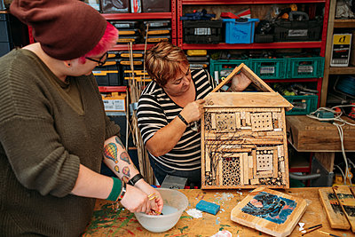 person showing off a bird or bug house