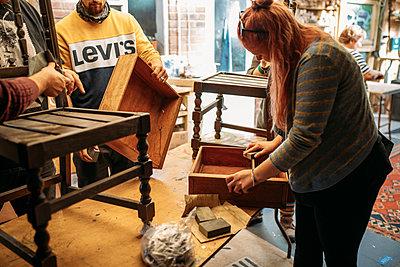 woman in a workshop preparing wood