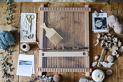 loom weaving supplies on a table
