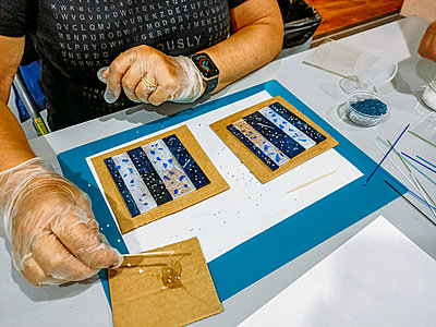person making glass coasters