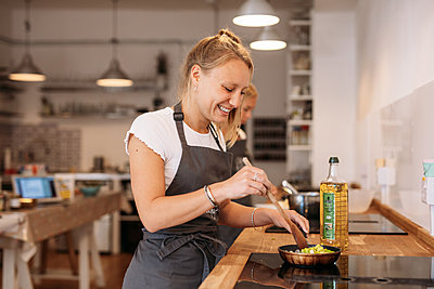 woman making Mexican street food in cookery workshop