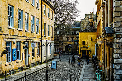 Old cobbled street with shops in Bath