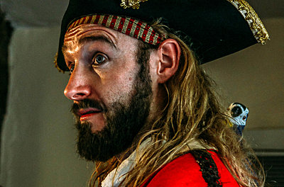 Side view of man dressed as Blackbeard the pirate