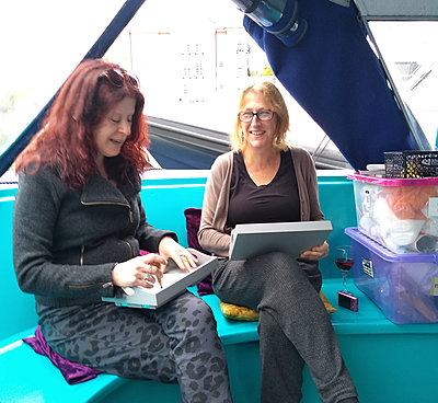 woman making Christmas cards on a boat