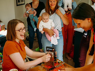 group of mums making food for their babies
