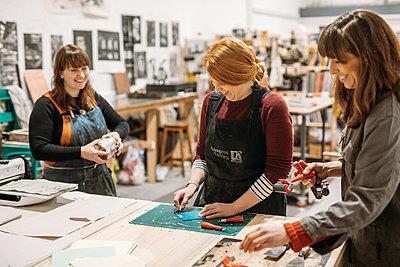 women in a printmaking workshop etching