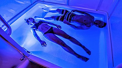 two people floating in a private flotation cabin