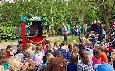 group of children watching a puppet show