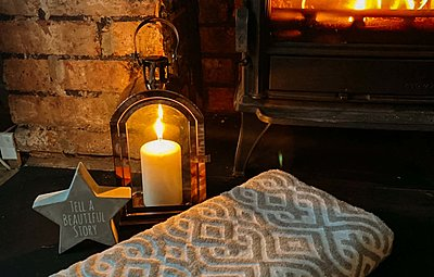 lit candle and roaring fire in a relaxation therapy room