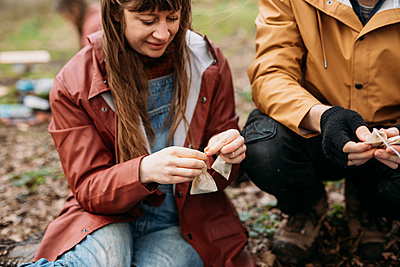 group outdoors making wild tea