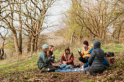 group sat in a circle in the woods
