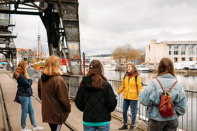 tour guide talking to a group on bristol harbourside