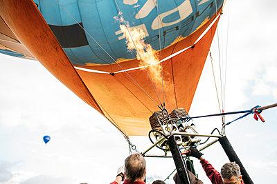Bailey balloons hot air balloon taking off as flames burn
