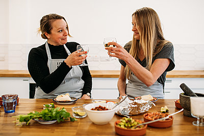 guests in a Mexican cookery class raising a toast