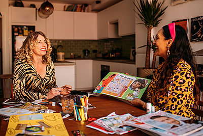 women looking happy and sharing a vision board