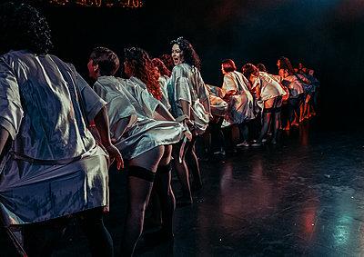 group of women in nightwear performing burlesque