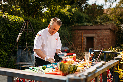barbecue chef preparing food outdoors