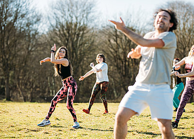 group taking part in an outdoor dance class