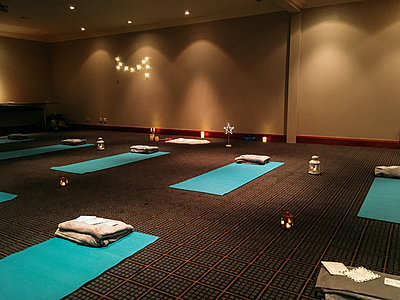 indoor relaxation session set up with yoga mats