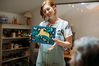 Illustrator Sarah Dennis presents her paper-cutting of a large cat and jungle scene