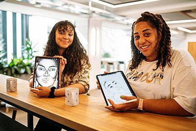 Guests present their portrait digital illustrations