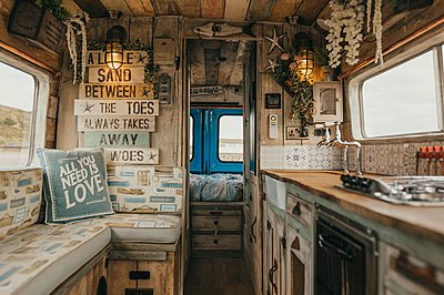 A nautical campervan decorated with vintage signs and shells