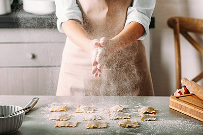 Host shapes ravioli at the counter and rubs dough between her hands