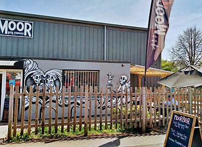 Moor Beer's exterior decorated with graffiti of drinking skulls