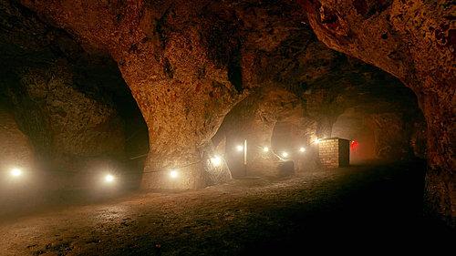 Soft lighting illuminates passageway into Redcliffe Caves