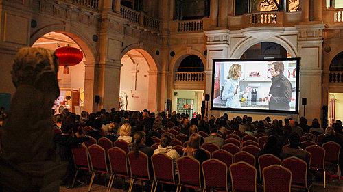 Cinema screen and audience inside Bristol Museum & Art Gallery