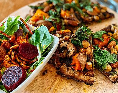 Wild mushroom vegan pizza with crunchy beetroot side salad