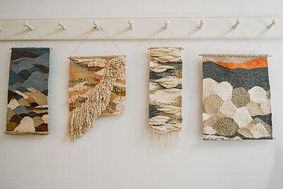 handmade weaving hanging on a wall