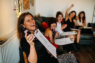 Guests turn around and reveal their life drawings, cheering and laughing together