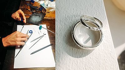 hands making silver rings in a workshop