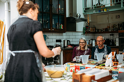 Guests watch host Margaret May give them a demo from her garden workstation