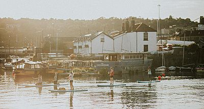 group stand up paddle boarding in Bristol harbourside