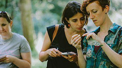 people looking at leaves