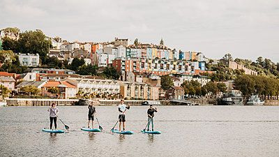 group paddle boarding in bristol harbour