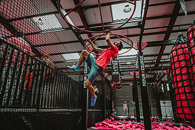 man bouncing on a trampoline in a trampoline park