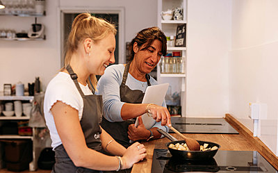 people making food on the hob in cookery workshop