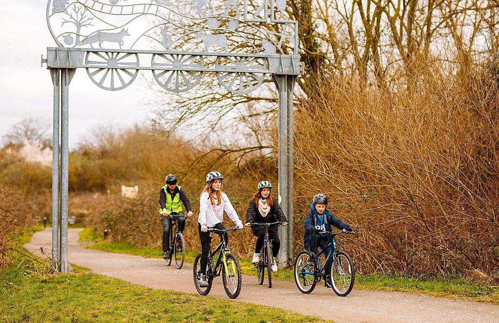 Family day out by bike on the Strawberry Line